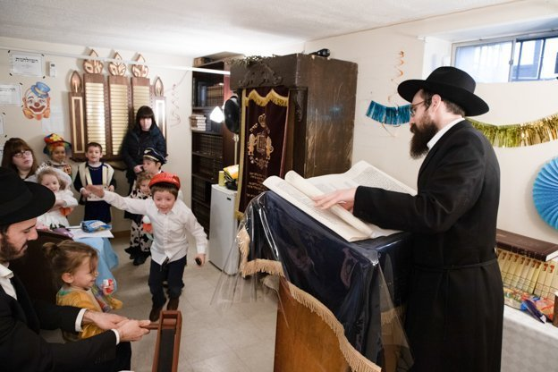 Purim Megillah Reading Children and adults alike came to listen to the megillah reading and when Haman Amolake's name was mentioned the children made loud noises with their gragers and noisemakers.